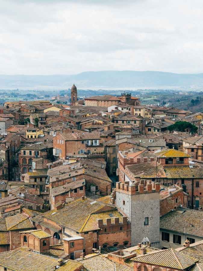 photo of brown and gray buildings to Buy a house in Italy for 1 euro