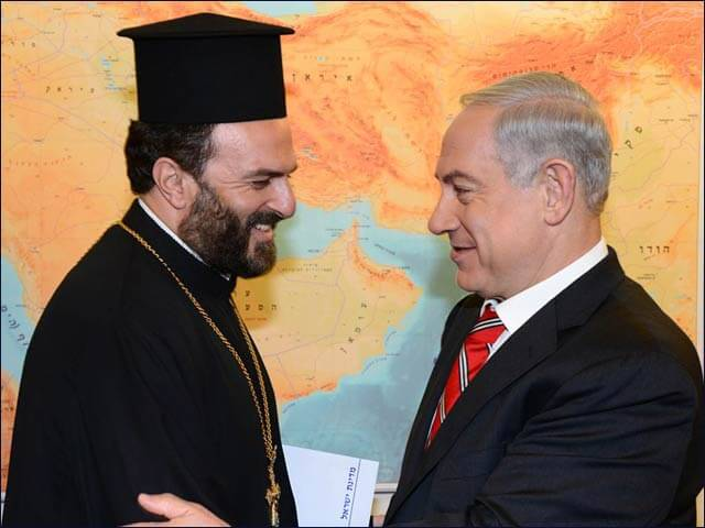 Prime Minister Benjamin Netanyahu and Father Gabriel Nadaf. (Photo: Israeli Government Press Office)