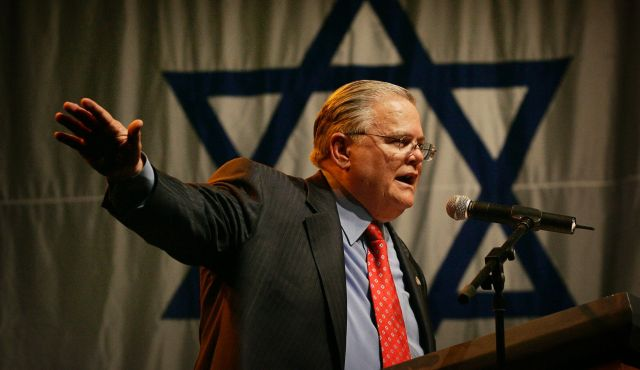 CUFI leader John Hagee speaks to Israel supporters at a rally at the Jerusalem convention center in 2008 (Photo: AP)