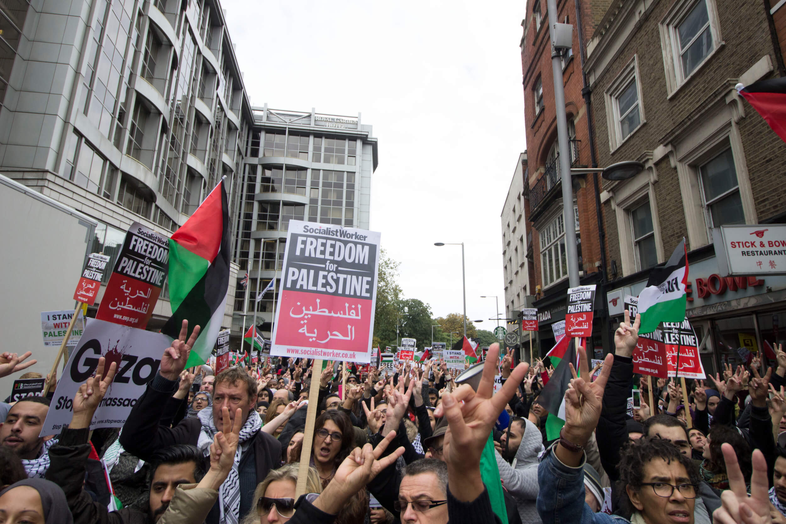 Some 2,500 protesters gathered in front of the Israeli embassy in High Street Kensington, London, raising their hands in signs of peace. (Photo: Sara Anna)