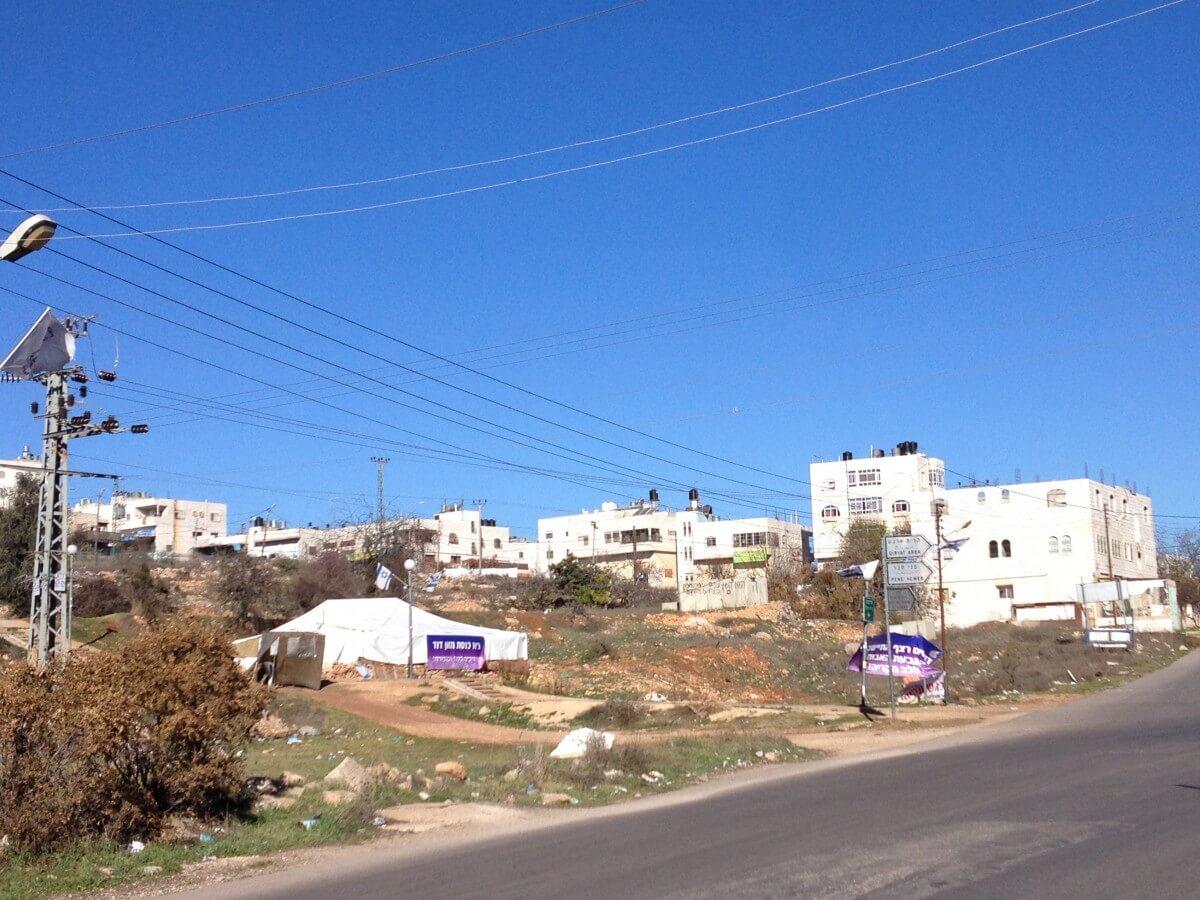 Synagogue tent built on the Jabari's land between Givat Ha'avot and Kiryat Arba settlements (Photo: EAPPI/Sabrina Tucci)