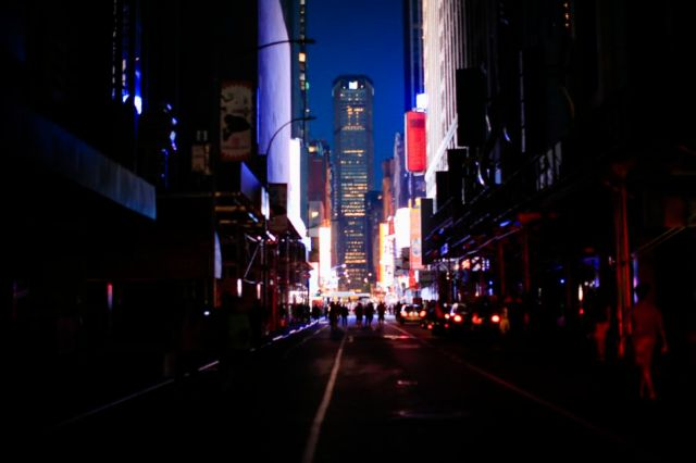 People make their way through the streets in Times Square during a major power outage on July 13, 2019 in New York City.