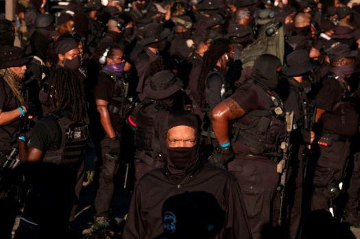 Members of the NFAC (Not Fucking Around Coalition), an all Black militia, participated in the protest too.