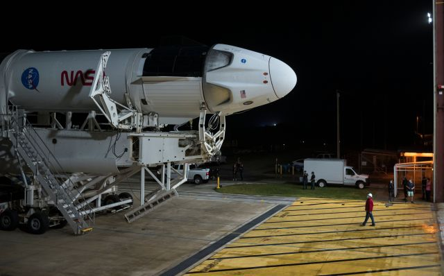 SpaceX's Crew Dragon spacecraft and Falcon 9 rocket as it was prepared for launch, becoming the first commercial spacecraft to take humans to space