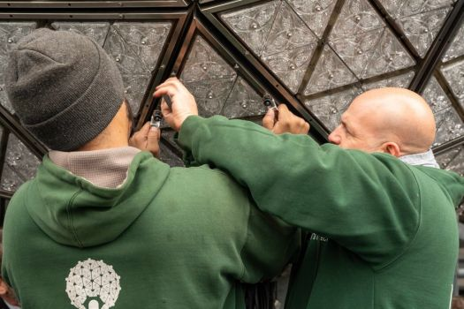Workers install new triangles in the Waterford Crystal ball for the 2020 celebration.