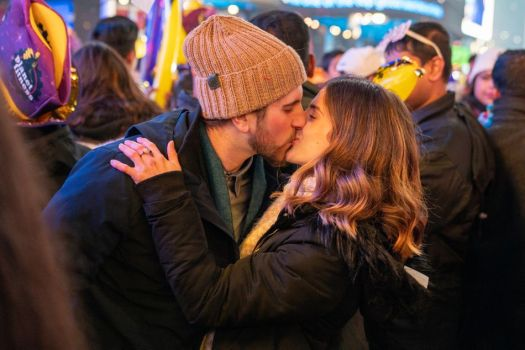 A couple kisses at midnight on New Year's Eve 2020 in Times Square.