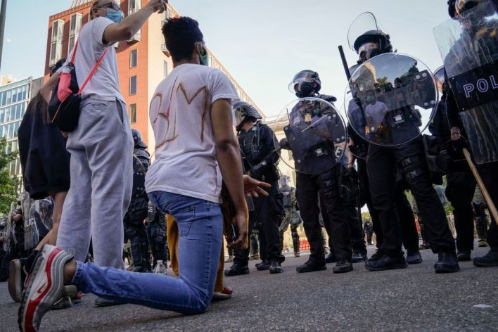 WASHINGTON, DC - JUNE 01: Demonstrators confront law enforcement during a protest on June 1, 2020 in downtown Washington, DC. Protests and riots continue in cities across America following the death of George Floyd, who died after being restrained by Minneapolis police officer Derek Chauvin. Chauvin, 44, was charged last Friday with third-degree murder and second-degree manslaughter.. (Photo by Drew Angerer/Getty Images)