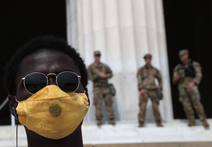 WASHINGTON, DC - JUNE 06: A demonstrator stands in front of the Lincoln Memorial during a peaceful protest against police brutality and the death of George Floyd, on June 6, 2020 in Washington, DC. People are expected to descend on Washington to participate in peaceful protests in the wake of the death of George Floyd, a black man who was killed in police custody in Minneapolis on May 25. (Photo by Win McNamee/Getty Images)