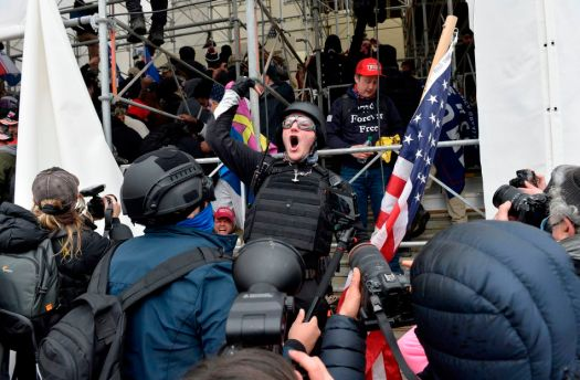 January 6, 2021: A man calls on people to raid the building as Trump supporters clash with police and security forces as they try to storm the U.S. Capitol in Washington D.C.