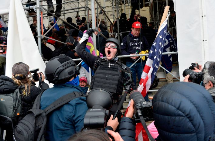 A man calls on people to raid the building as Trump supporters clash with police and security forces as they try to storm the US Capitol in Washington D.C on January 6, 2021. - Demonstrators breeched security and entered the Capitol as Congress debated the a 2020 presidential election Electoral Vote Certification. (Photo by Joseph Prezioso / AFP) (Photo by JOSEPH PREZIOSO/AFP via Getty Images)
