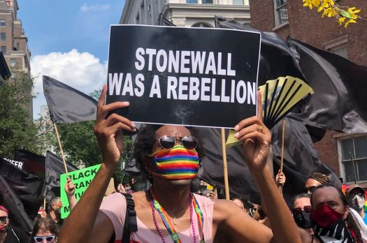 A protester holds a sign during the Queer March for Black Lives on June 28, 2020 in New York City.