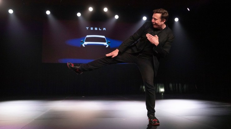 Elon Musk karate kicking his way to victory.