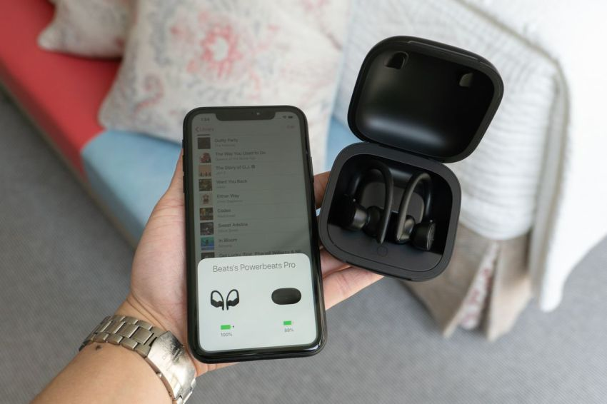 Pairing Powerbeats Pro works the same way as AirPods: place them next to an iPhone and open the case.