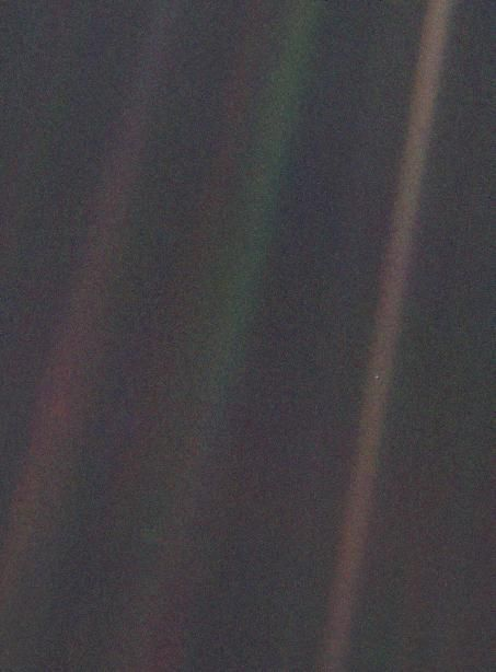 """Carl Sagan's cosmic """"family portrait"""" of our solar system, including the Pale Blue Dot"""