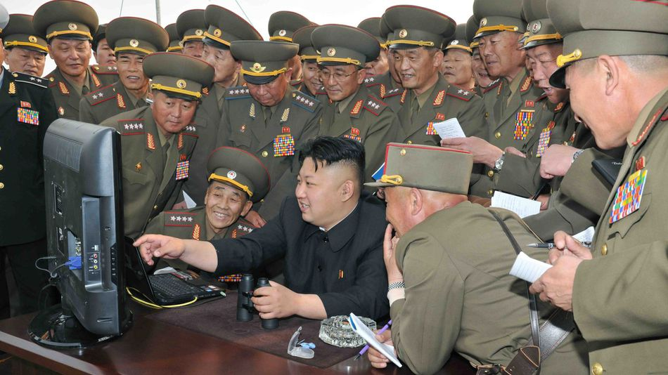 An undated handout picture released by the North Korean Central News Agency (KCNA) on April 27, 2014 shows North Korean leader Kim Jong-un looking at a computer screen.