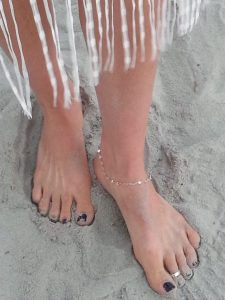 priceless moments wedding feet in the sand