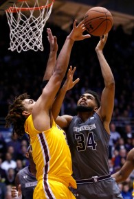 Minnesota center Reggie Lynch, left, blocks a shot by Northwestern guard/forward Sanjay Lumpkin during the second half. Minnesota won 70-66. (AP Photo/Nam Y. Huh)