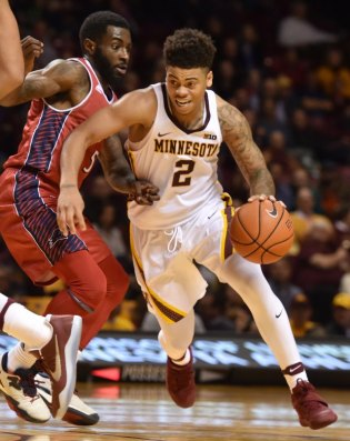 Minnesota Golden Gophers guard Nate Mason drives to the basket against N.J.I.T Highlanders guard Damon Lynn in the second half at Williams Arena on Tuesday, Dec. 6, 2016. The Gophers beat the Highlanders, 74-68. (Pioneer Press: John Autey)