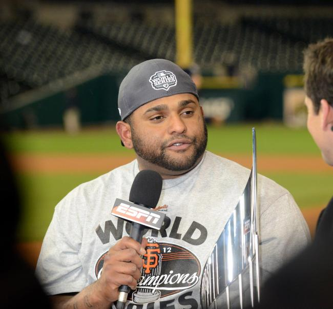 Pablo Sandoval accepting the 2012 World Series MVP Award in Detroit. He cashed in after winning another World Series in 2014.