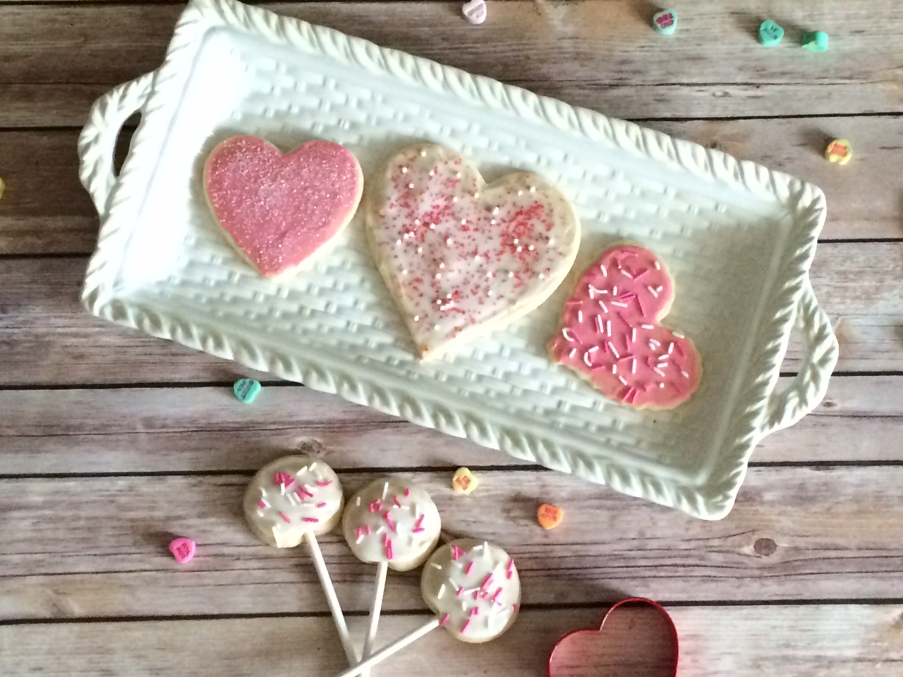 You are going to want to make these homemade Valentine's Day Cut-Out Sugar Cookies! #ValentinesDay #Valentine #valentinedessert #valentinecookies #cookies #cookierecipe #sugarcookies #frostedcookies #sugarcookierecipe #homemadecookies