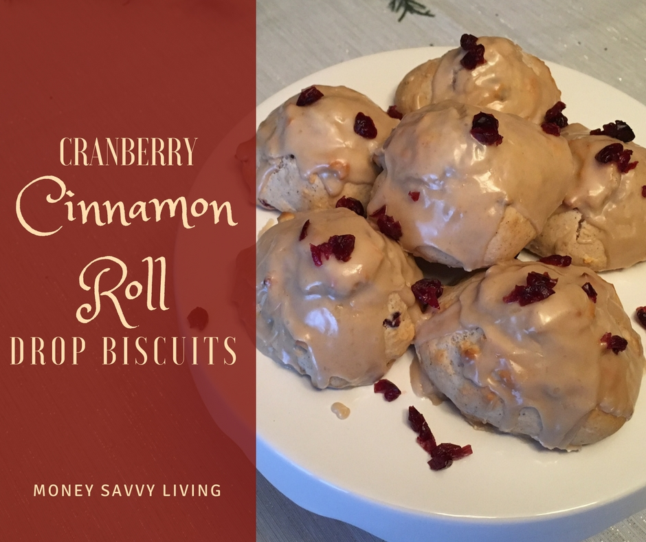 These Cranberry Cinnamon Roll Drop Biscuits are so easy to make.... perfect for a sweet treat on Christmas morning! | Money Savvy Living #christmas #christmasbreakfast #brunch #cinnamonrolls #dropbiscuits #cranberry #maplefrosting #christmasbrunch