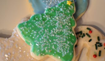 If you love traditional iced sugar cookies at Christmas, you need to try these! This classic recipe tastes delicious, and they are fun to decorate! #Christmas #christmascookies #cookies #cookierecipe #christmascandy #sugarcookies #frostedcookies #icedcookies
