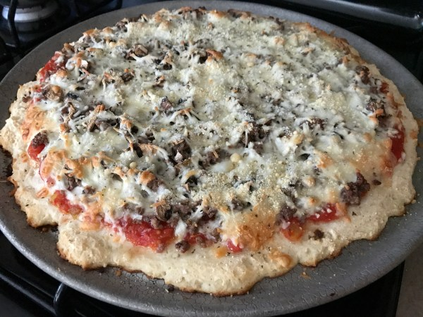 This pizza dough is quick and easy to make, it tastes delicious... and it's healthy too! Gluten Free 2-Ingredient Pizza Dough #glutenfree #glutenfreepizzadough #pizzadough #2ingredientpizzadough #pizza #healthypizza #healthyliving #healthycooking