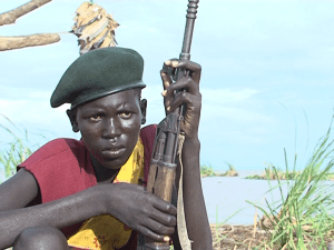 Fifteen Year old Loyiane Ekai Resident Todonyang with his riffles