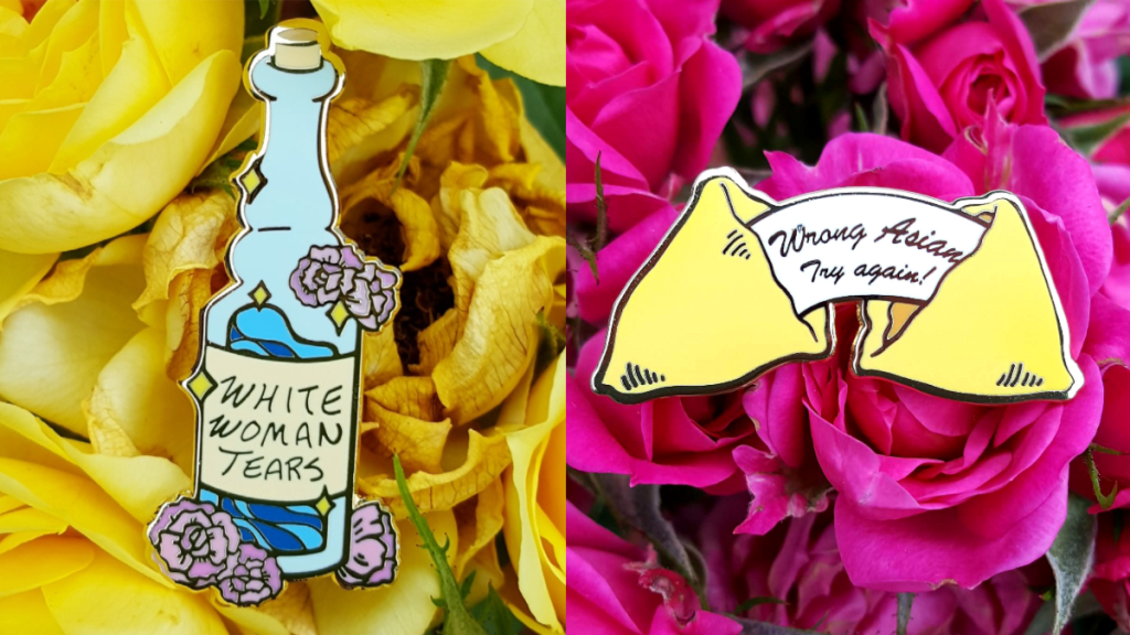 two enamel pins against yellow and pink roses