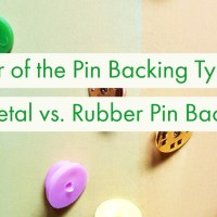 War of the Pin Backing Types: Metal vs. Rubber Pin Backs