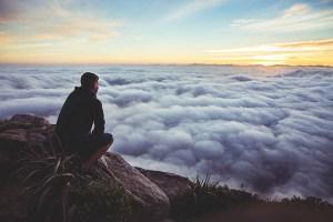 man looking at clouds