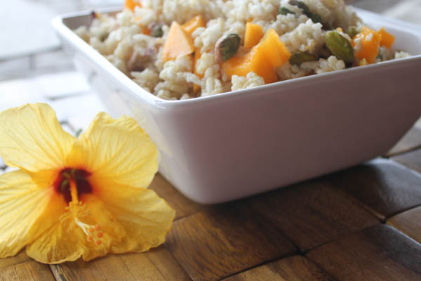Tropical coconut rice with fresh papaya and pistachios