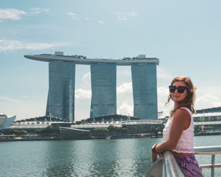 Girl in front of Marina Bay Sands building in Singapore