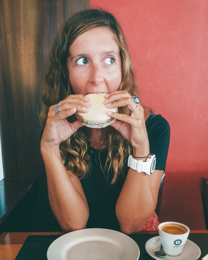 Girl eating alfajores in Buenos Aires Argentina