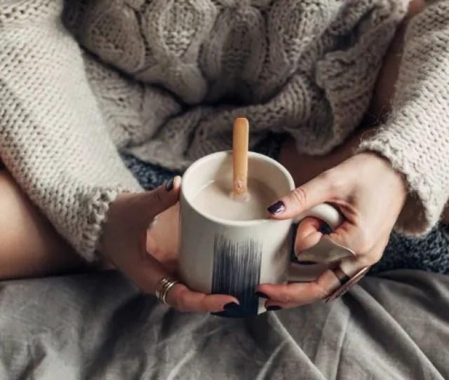 Caucasian Woman Enjoying A Mug Of Hot Coffee In The Morning