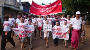 Locals marching in protest against the coal-fired plant
