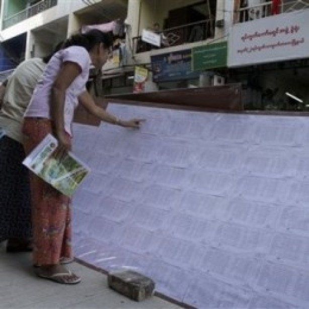 Local residents checking the lists of eligible voters posted
