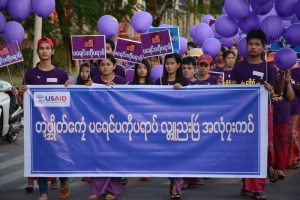 Locals march in Mawlamyine Capital holding the International Day of Elimination of Violence Against Women banner (Photo: MNA)