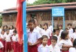 students are paying respect to national flag at a Mon National School (photo: MNA)