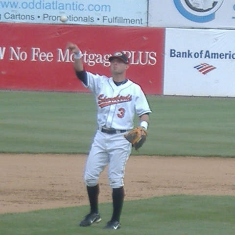 Ryan Adams flips the ball into the dugout, ready for another half-inning of defensive work.