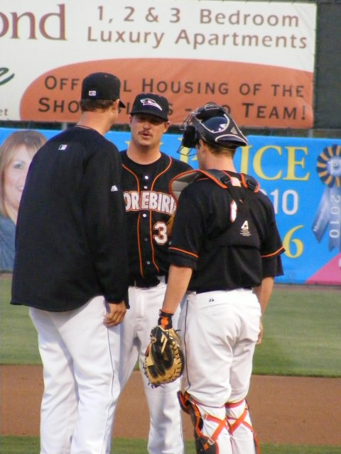 Hitting a rough patch in his first start of the year April 11, Scott Copeland gets advice from pitching coach Troy Mattes and catcher Justin Dalles.