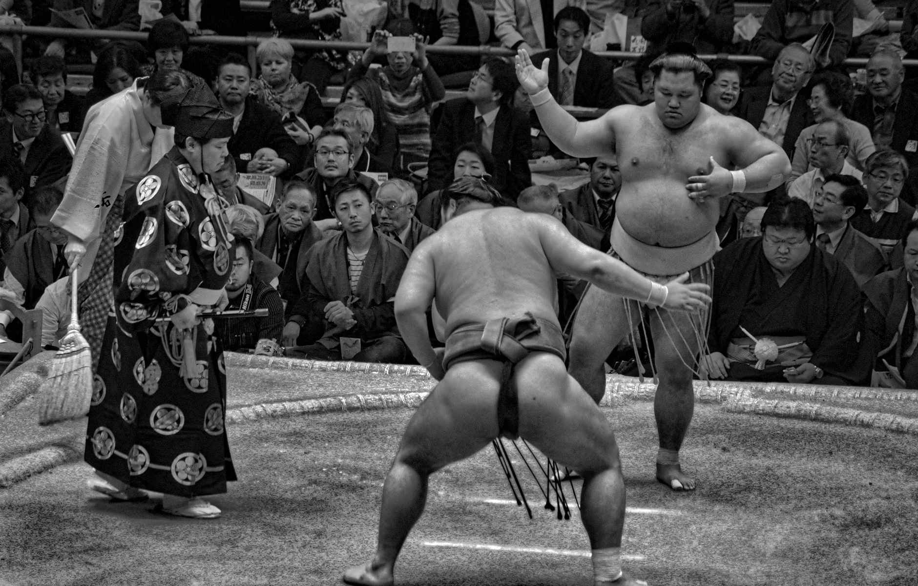 grayscale photo of a sumo wrestling match
