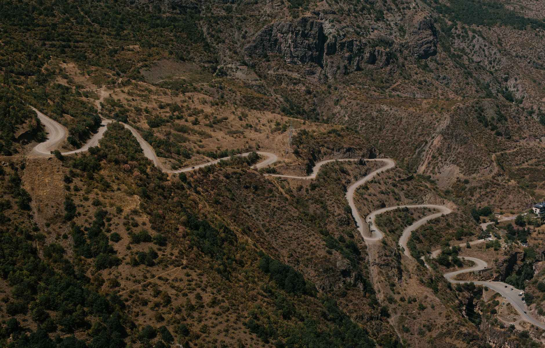 asphalt winding roadway on mountain slope