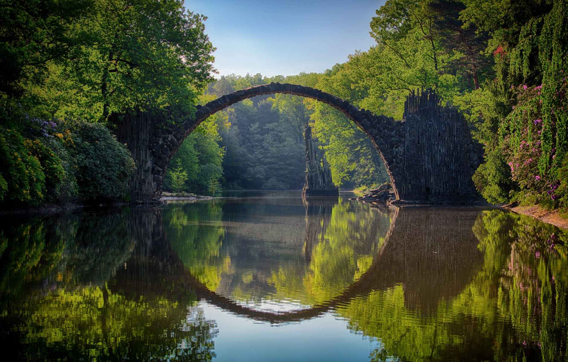 gray bridge and trees