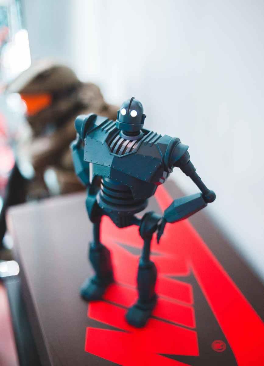 modern toy robot on bright shelf near wall