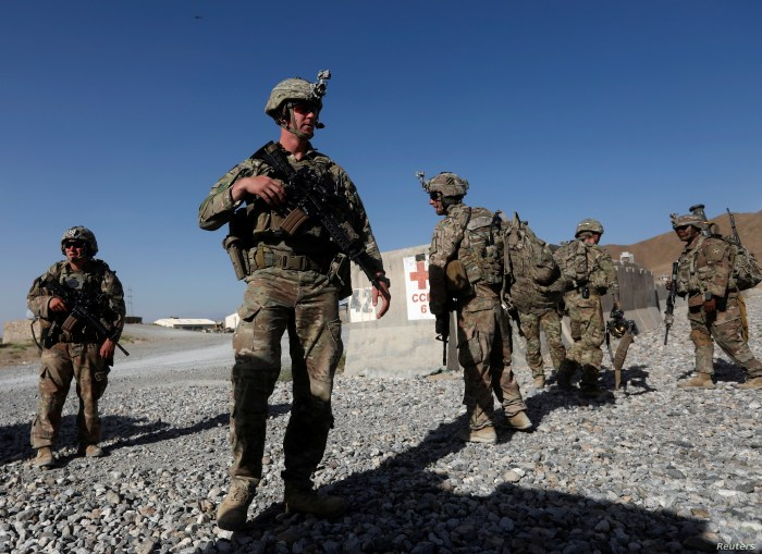 U.S. troops wait for their helicopter flight at an Afghan National Army (ANA) base in Logar province, Afghanistan, Aug. 7, 2018.
