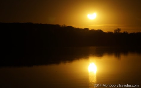 Solar Eclipse Being Reflected in the Water
