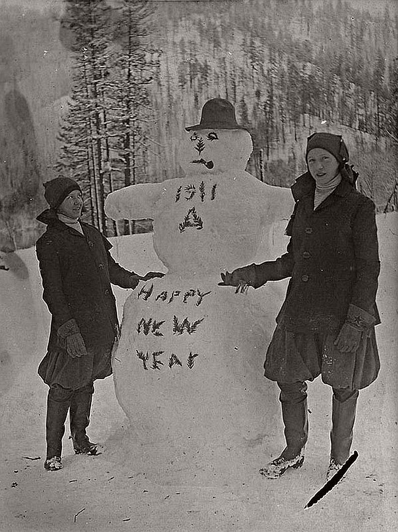 Vintage  Happy New Year  in the past    MONOVISIONS Two children with a snowman greeting the New Year 1911