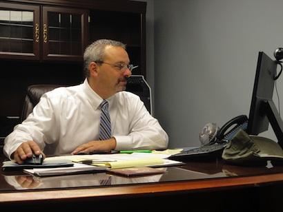 Captain Chris White at desk
