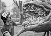 John Dods applies clear coat to the Monster's teeth.